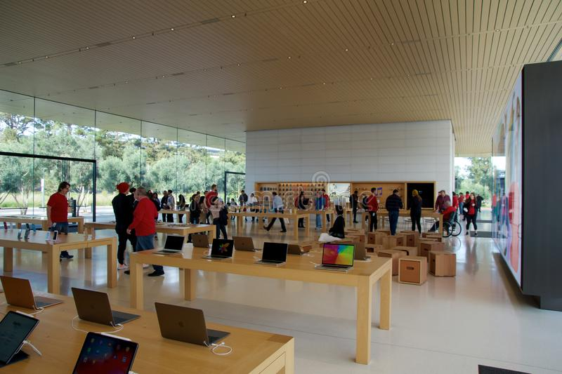 CUPERTINO, CALIFORNIA, UNITED STATES - NOV 26th, 2018: Interior with many customers in the new Apple store and royalty free stock photo