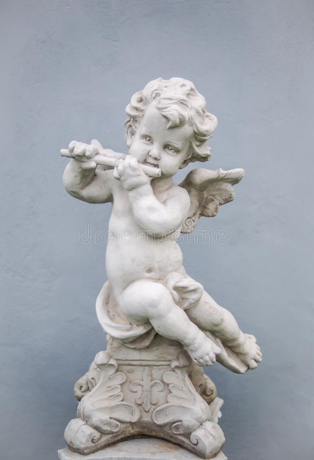 Cupid with Flute royalty free stock photo