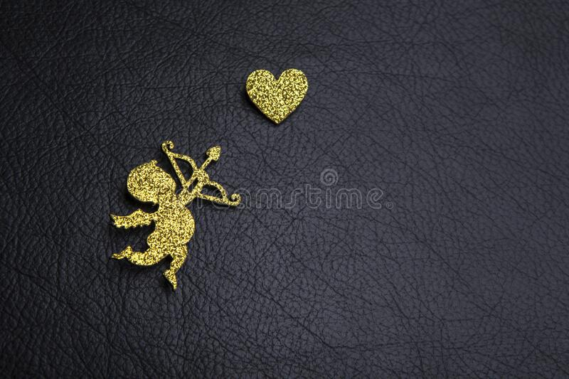 Cupid heart dark leather background. Studio stock photography