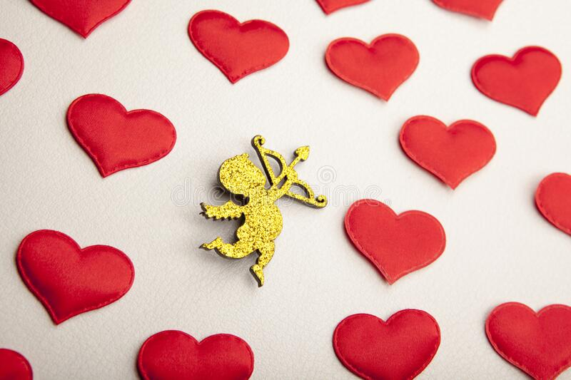 Cupid heart white leather background. Studio royalty free stock photography