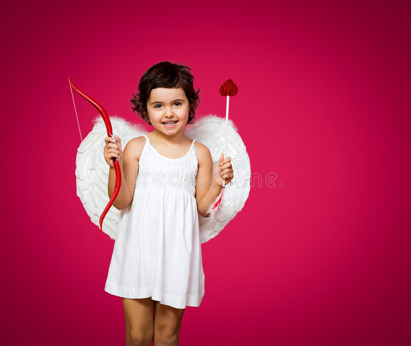 Cupid little girl. With a bow, arrow and wings stock photo