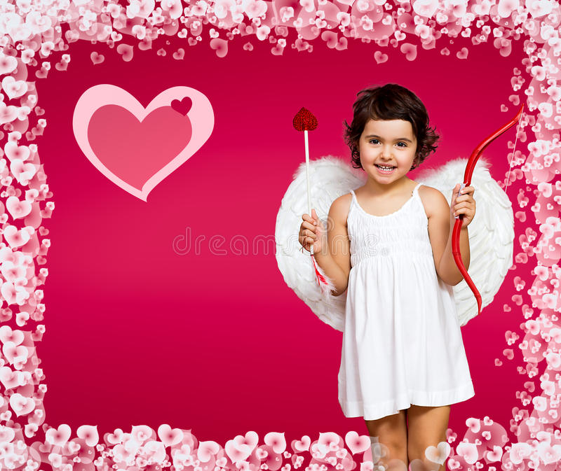 Cupid little girl. With a bow, arrow and wings stock photos