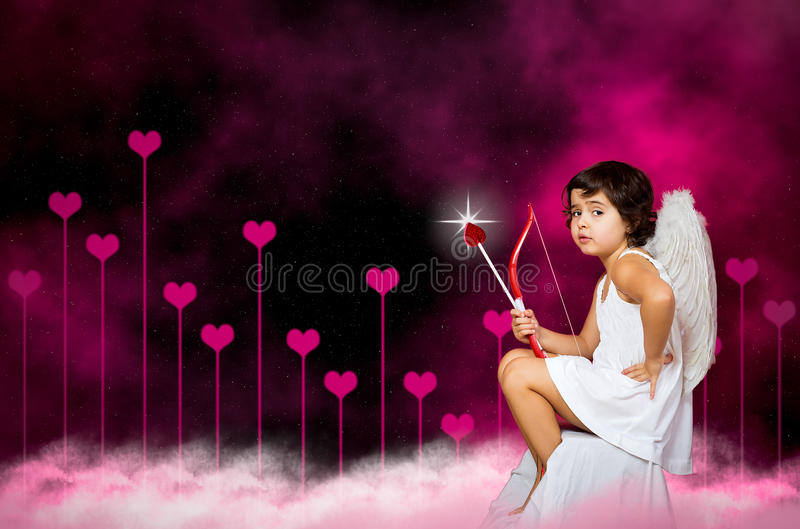 Cupid little girl. With a bow, arrow and wings royalty free stock images