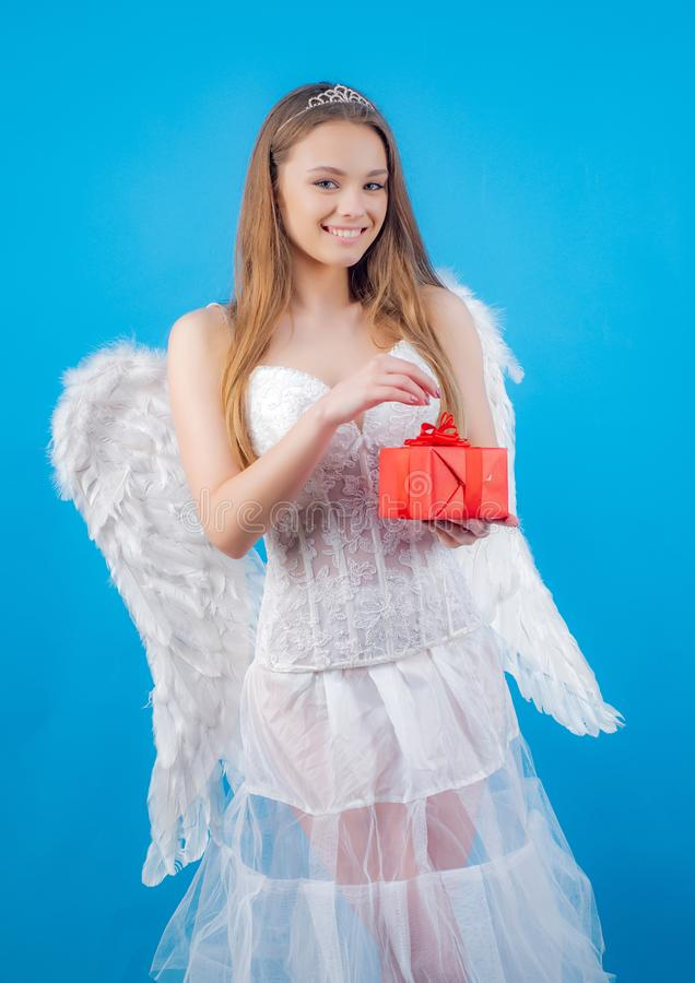Cupid in valentine day. Beauty blue her eyes - charming lady with feather wings. Lovely girl. Angel in love present gift. Lovely girl cupid with bow and arrow stock photo