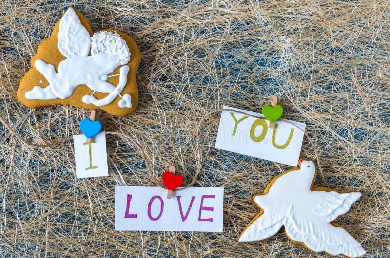 Cupido do anjo e azul branco Eu te amo Doces de chocolate imagem de stock royalty free