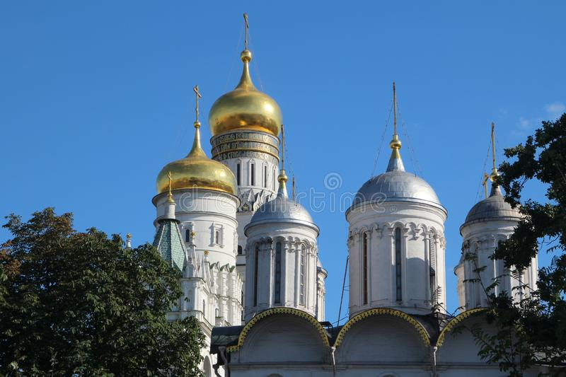 Cupolas of Cathedrals in Moscow Kremlin. Golden cupolas of orthodox cathedrals at Sobornaya square in Moscow Kremlin royalty free stock photography