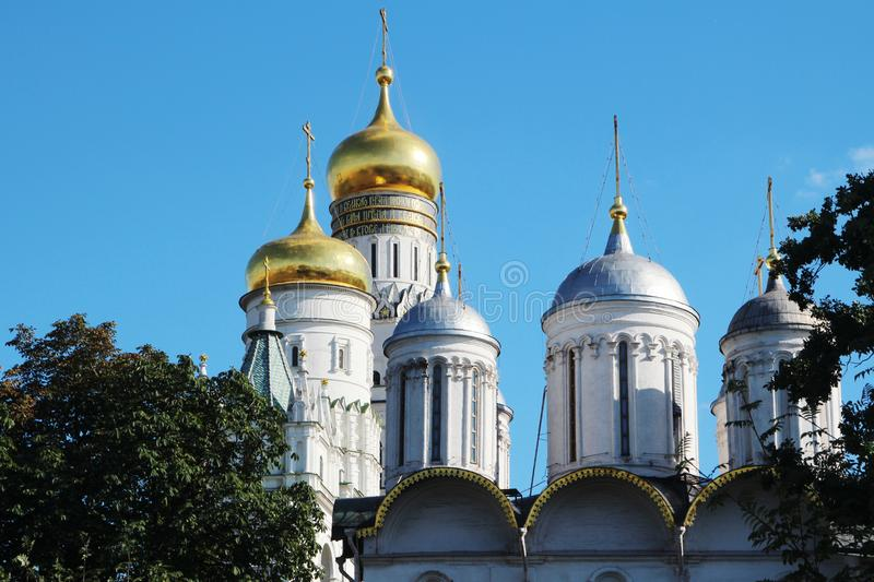 Cupolas of Cathedrals in Moscow Kremlin. Golden cupolas of orthodox cathedrals at Sobornaya square in Moscow Kremlin royalty free stock image