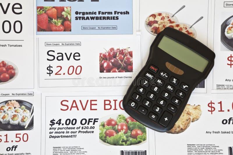 Cupones y calculadora falsas fotografía de archivo libre de regalías