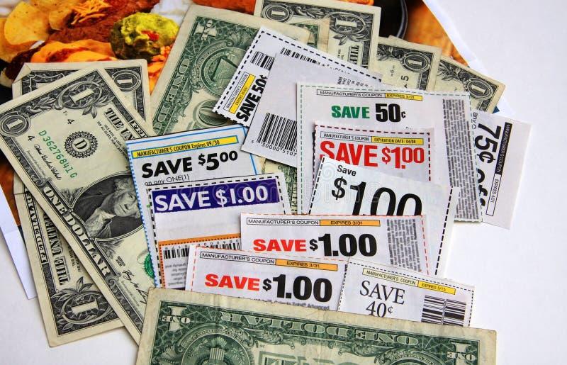Cupones y dólares imagen de archivo libre de regalías