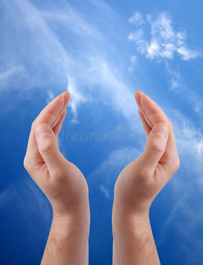 Cupped hands. Isolated on sky background stock photo