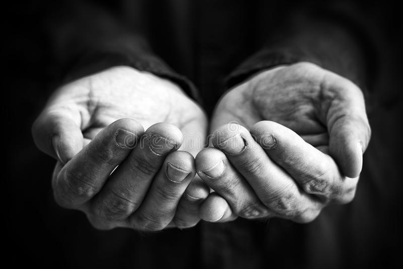 Cupped hands. Of a man hopefully held up.  asking for something stock photos