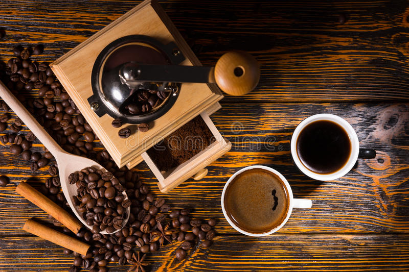 Cups of Black Coffee with Grinder and Roast Beans royalty free stock image
