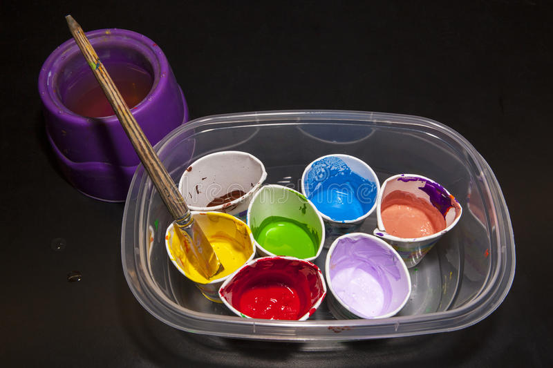 Cups of Bright Artist's Paint Colors stock image