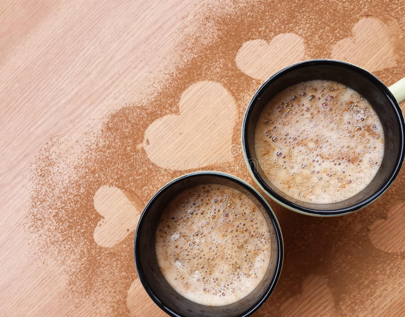 Cups of cappucino on wooden background royalty free stock photography