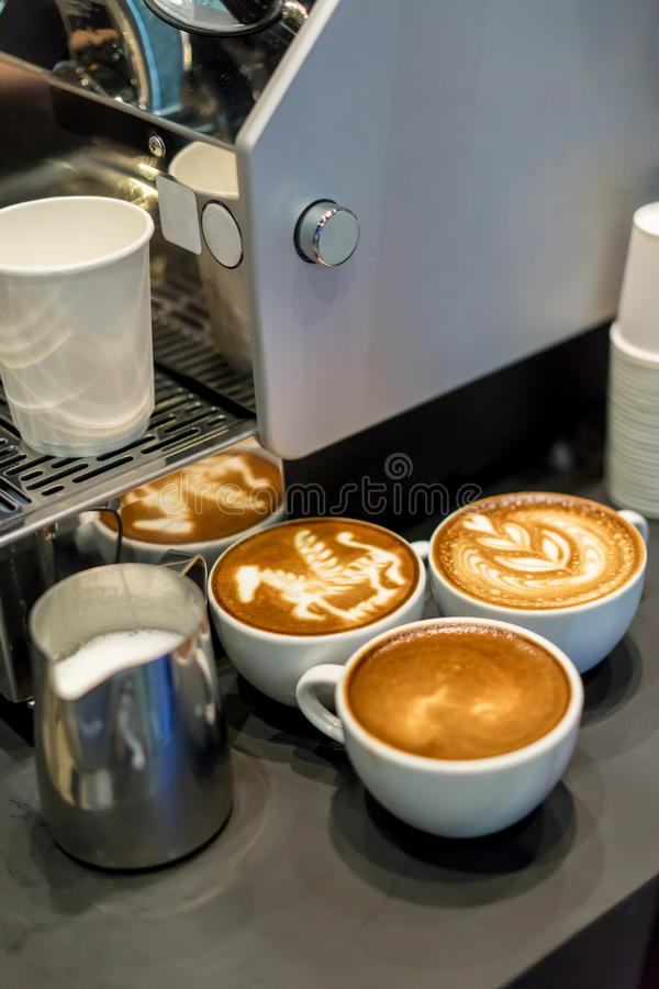 Cups of coffee with beautiful Latte art on grey table. royalty free stock photography