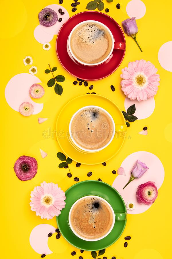 Cups of Coffee and colorful paper circles on yellow paper background stock images
