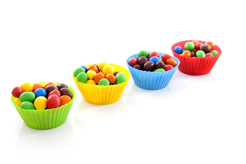 Cups with colorful candy stock image