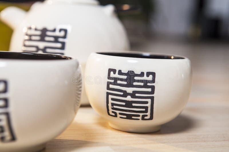 cups den japanska teapoten fotografering för bildbyråer