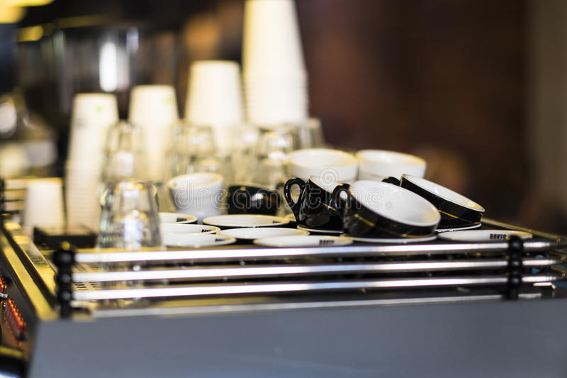 Cups on espresso machine stock photo