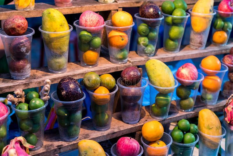 Display of Fruits for Fruit Juice and Shakes. Street Stall Vendor at Night Market in Luang Prabang, Laos royalty free stock photography