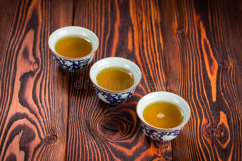 Cups with green tea on wooden background royalty free stock images