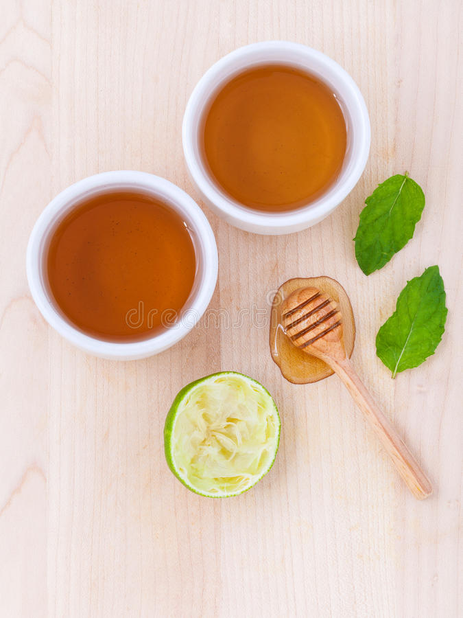 Cups of herbal tea with aromatic herbal with lemon , lime. And honey stock photos