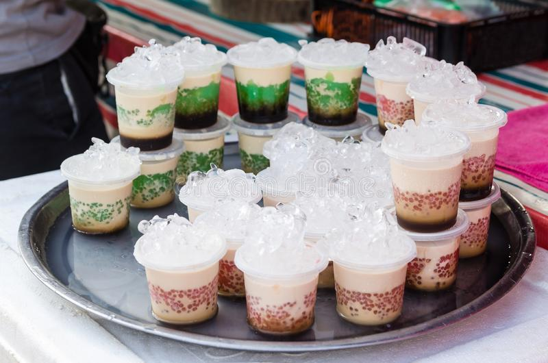 Cups of homemade pudding selling at the market stall royalty free stock image
