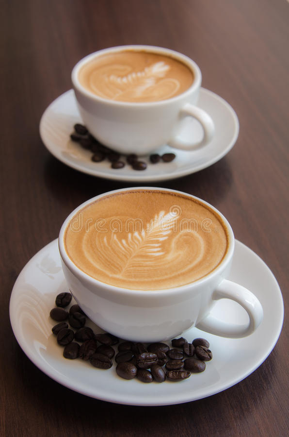 2 cups of latte art coffee stock photography