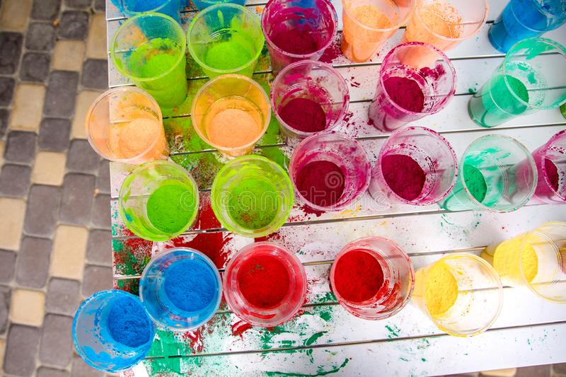 Cups with paint for the Indian Holi festival colours stock images