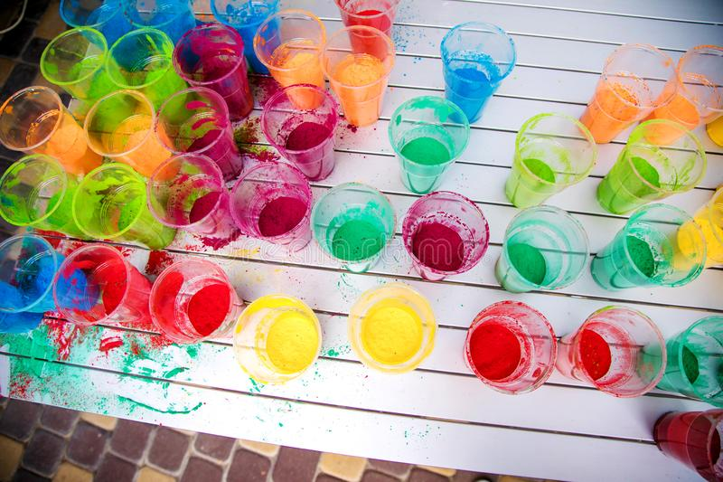 Cups with paint for the Indian Holi festival colours royalty free stock photography
