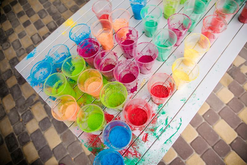 Cups with paint for the Indian Holi festival colours stock image