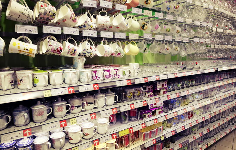 Cup retail store. Cups on sale on shelf at home department of supermarket. Cup in retail store stock images
