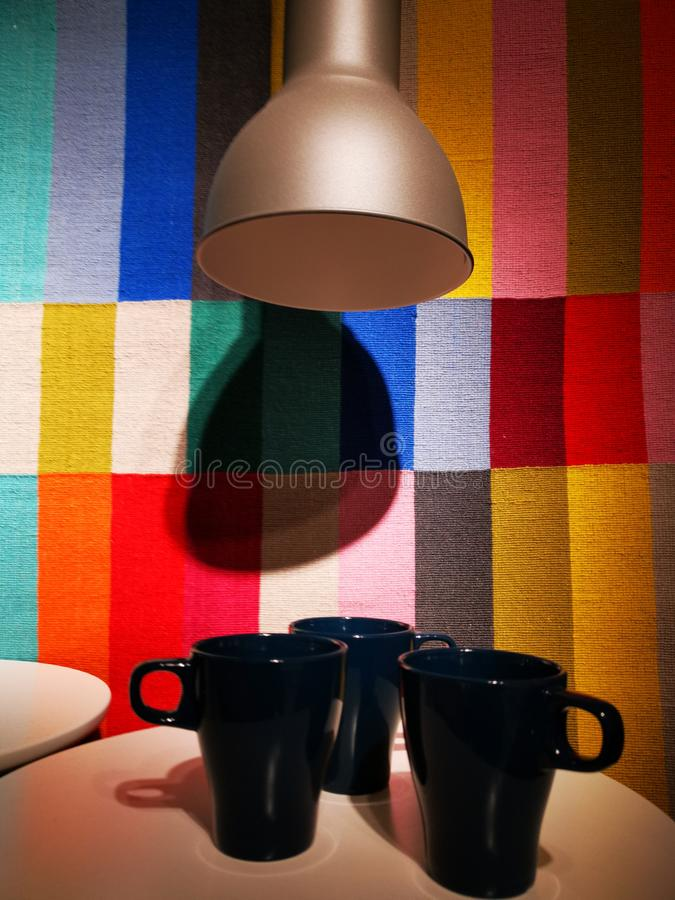 Cups on the table and the lamp above royalty free stock images