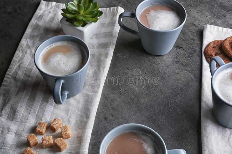 Cups with tasty aromatic coffee on grey table royalty free stock image
