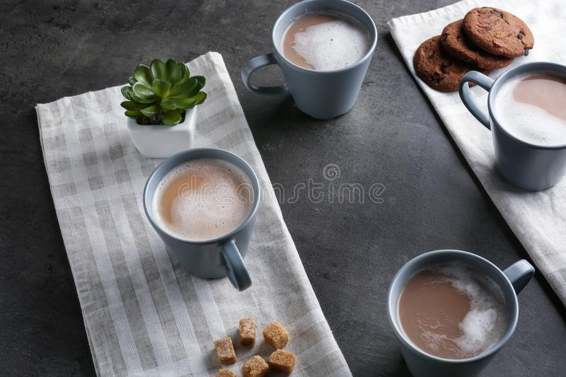 Cups with tasty aromatic coffee on grey table stock image