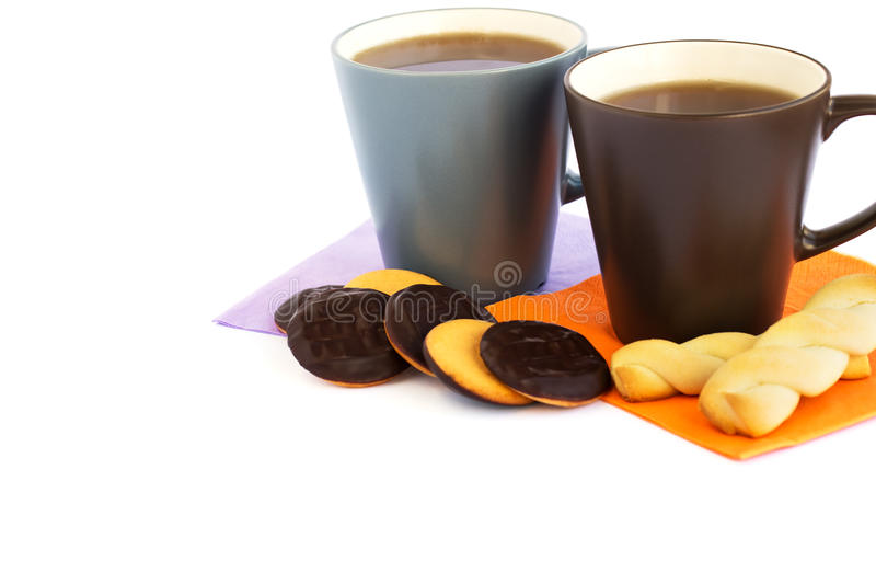 Cups of tea and cookies stock images