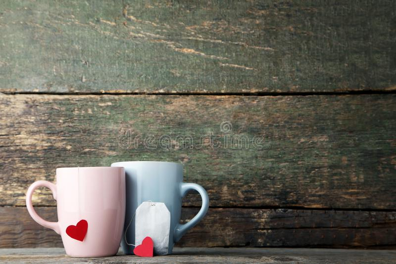Cups of tea with hearts and teabag stock photo
