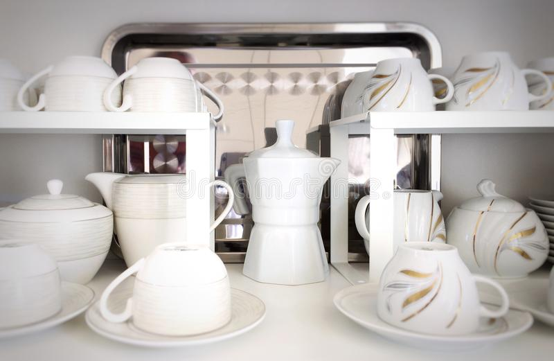 Cups on the white shelves. In the store stock images