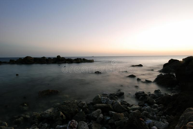 Curacao, long exposure classic seascape after sunset stock photography