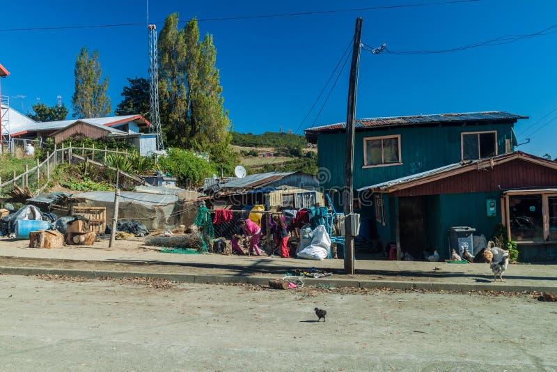 CURACO DE VELEZ, CHILE - MARCH 21, 2015: Poor houses of fishermen in Curaco de Velez village, Quinchao island, Chi stock photo