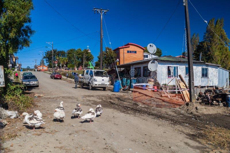 CURACO DE VELEZ, CHILE - MARCH 21, 2015: Poor houses of fishermen in Curaco de Velez village, Quinchao island, Chi stock images