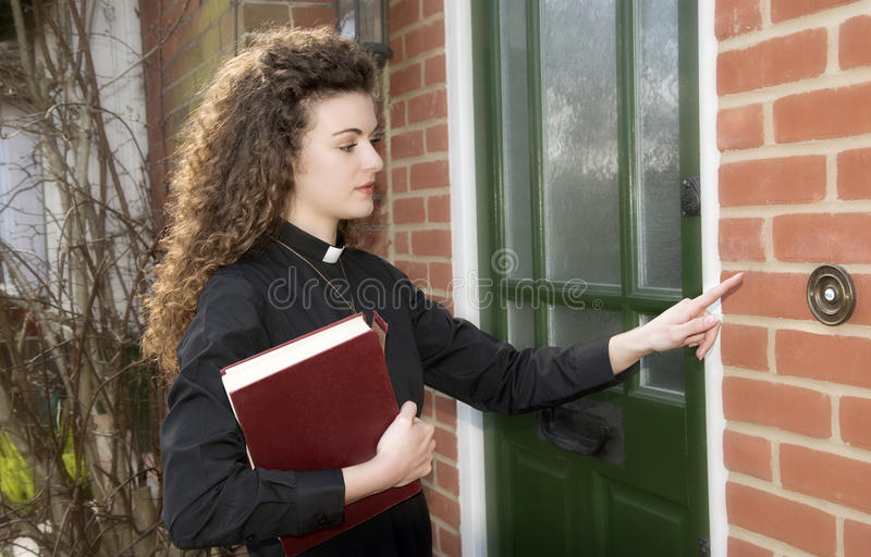 Curate wearing dog collar making house call stock photos
