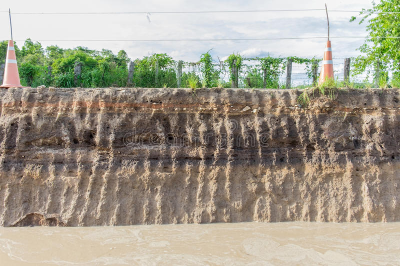 The curb erosion from storms. To indicate the layers of soil. And rock stock images