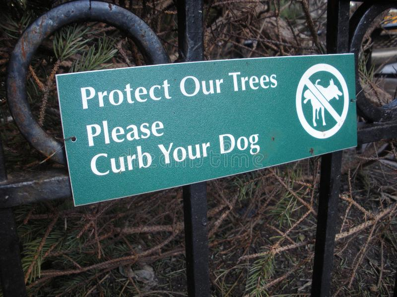Curb Your Dog Sign, Protect Our Trees, NYC. Protect Our Trees, Please Curb Your Dog: Small sign in New York City asking dog owners to respect the neighborhood royalty free stock photos