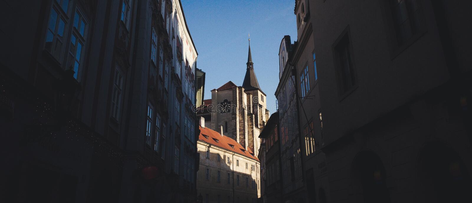 Curch in Prague, Czech Republic. View of a church with buildings in the shadow. Prague, Czech Republic royalty free stock photos