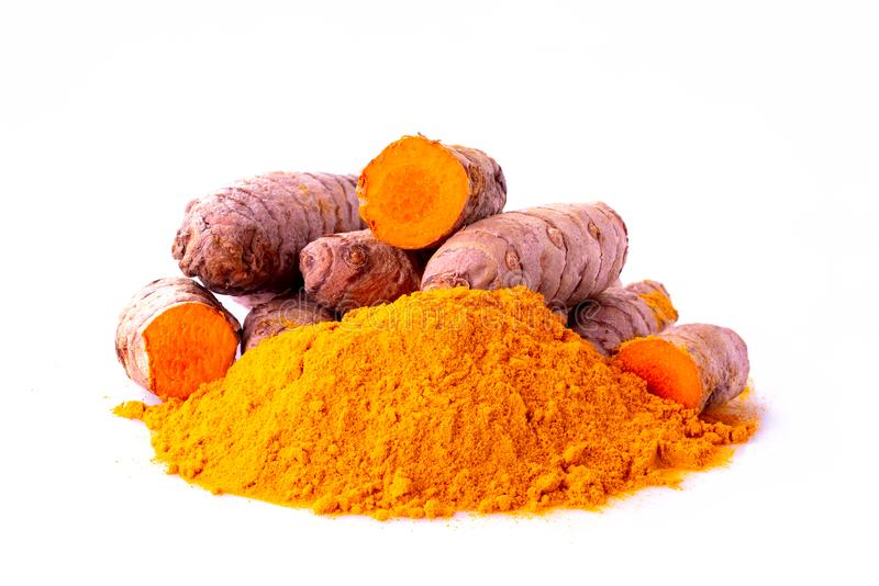 Curcuma turmeric spice roots and ground royalty free stock photography