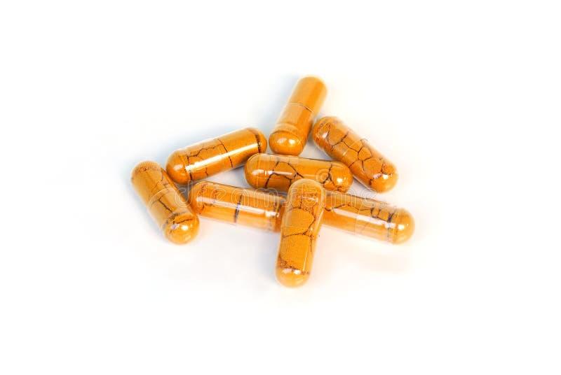 Curcumin powder capsule. royalty free stock photo