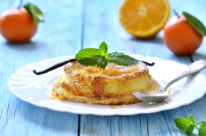 Curd souffle with orange and vanilla. Curd souffle with orange and vanilla on a wooden table stock images