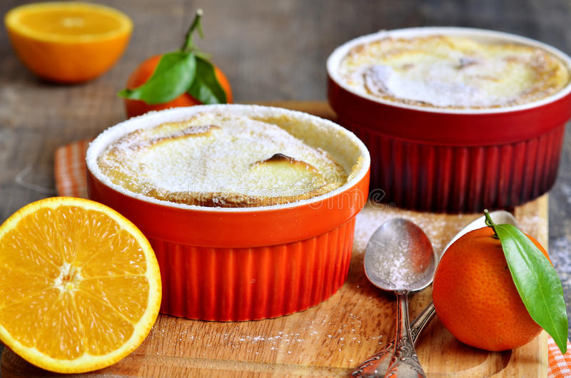 Curd souffle with orange and vanilla. Curd souffle with orange and vanilla on a wooden table stock photo