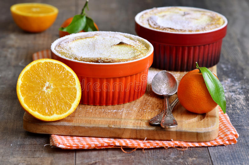 Curd souffle with orange and vanilla. Curd souffle with orange and vanilla on a wooden table royalty free stock photos